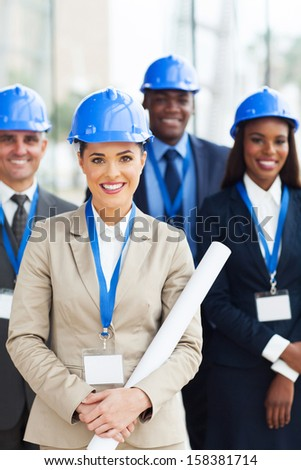 group of happy architects in office - stock photo