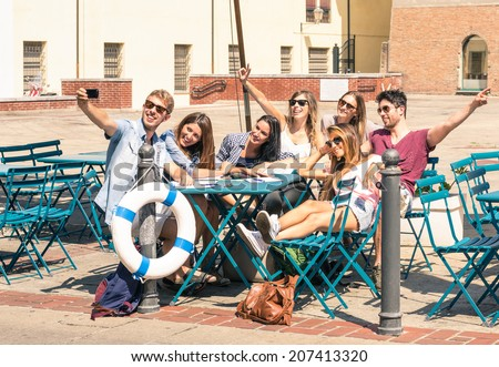 Group of happy best friends taking a selfie - Tourists having fun in the summer around the old town - University students during a break in a sunny day - stock photo