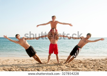 Group of happy boys at the beach