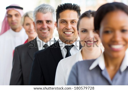 group of happy business executives standing in a row - stock photo