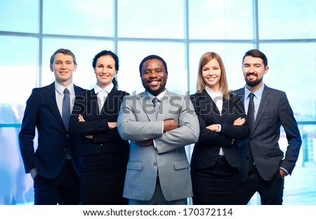 Group of happy business partners looking at camera with smiles