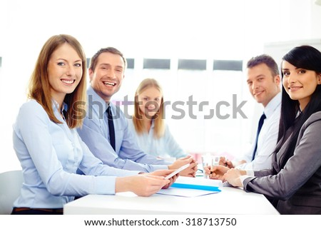 Group of happy business people at meeting - stock photo