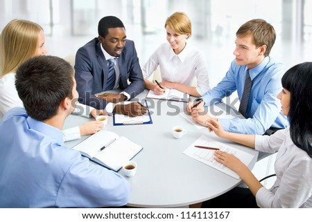 Group of happy business people in a meeting at office