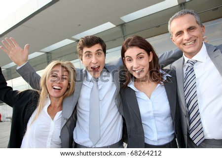 Group of happy business people standing outside