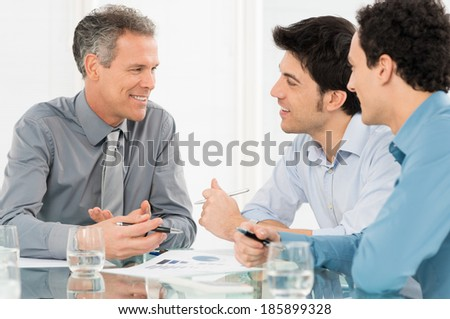 Group Of Happy Businessmen Having Conversation In Meeting - stock photo