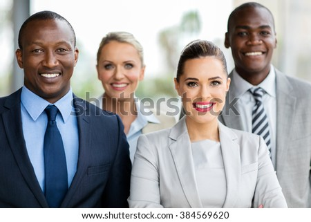 group of happy businesspeople in modern office - stock photo
