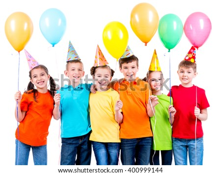 Group of happy children in colored t-shirts with balloons on a white background. - stock photo