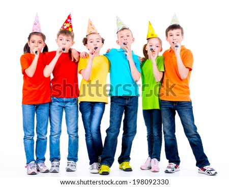 Group of happy children in colored t-shirts with party blowers - isolated on a white background. - stock photo