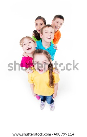 Group of happy children in colorful t-shirts standing together. Top view. Isolated on white. - stock photo