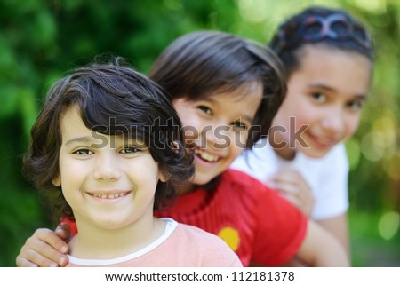 Group of happy children outside