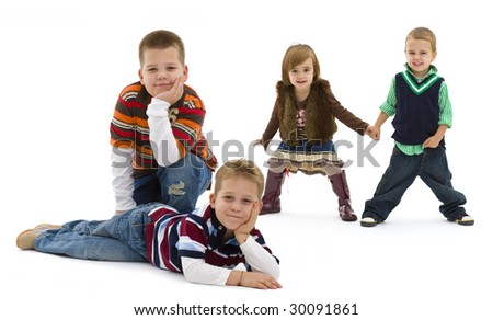Group of 4 happy children posing together.  smiling. Isolated on white background. - stock photo