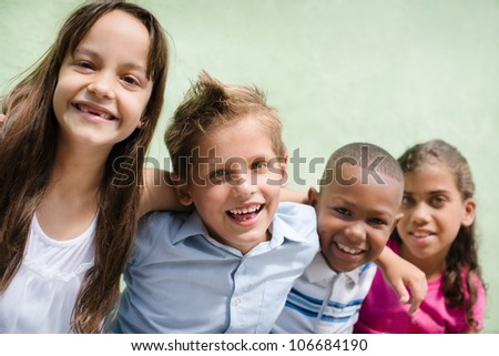 Group of happy children smiling, embracing and looking at camera. Copy space - stock photo