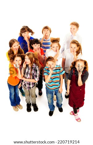 Group of happy children standing together and shouting. Isolated over white. - stock photo