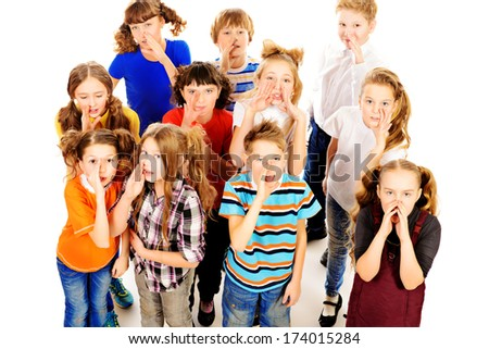 Group of happy children standing together and talking. Isolated over white. - stock photo