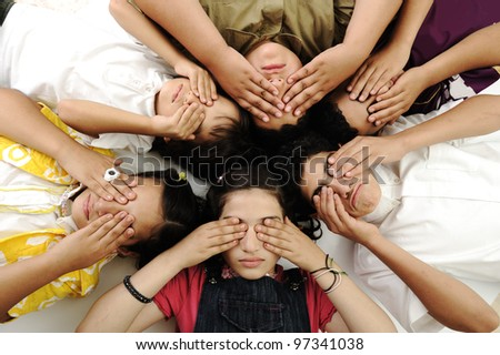 Group of happy children with closed eyes - stock photo