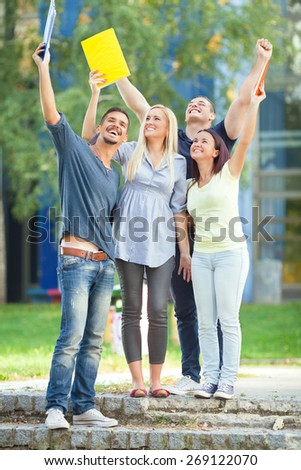 Group of happy college students after finishing final exams - stock photo