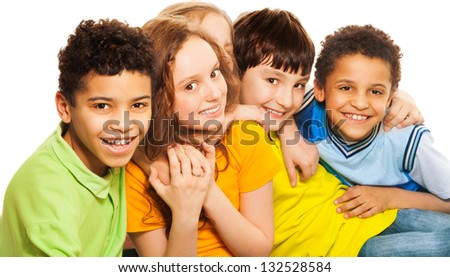 Group of happy diversity looking boys and girls smiling, laughing and hugging - stock photo
