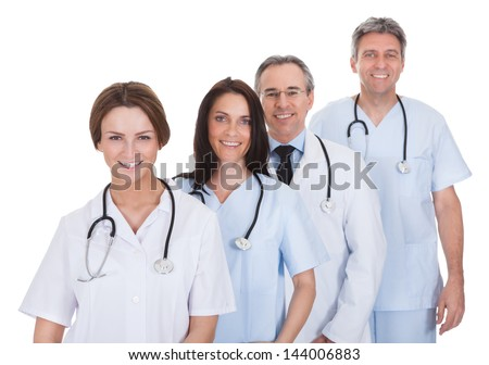 Group Of Happy Doctor Standing In A Row Over White Background