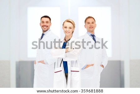 group of happy doctors at hospital - stock photo
