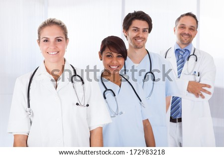 Group Of Happy Doctors Standing In A Row With Stethoscope - stock photo