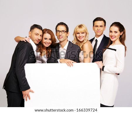 Group of happy elegant friends - stock photo