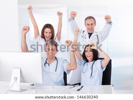 Group Of Happy Excited Doctor Raising Arm - stock photo
