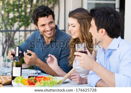 Group Of Happy Friends Having Dinner At Patio Outdoor - stock photo