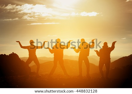 Group of happy friends having fun on sunset background