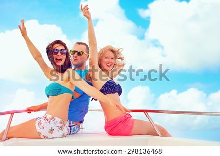 group of happy friends having fun on yacht, during summer vacation - stock photo