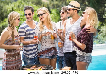 Group of happy friends having juice while enjoying together - stock photo