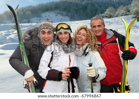 Group of happy friends in winter vacation - stock photo
