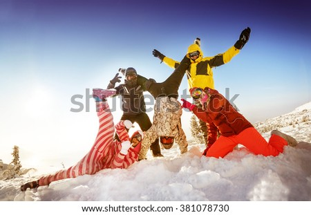 Group of happy friends skiers and snowboarders having fun on the slope of a mountain. Sheregesh resort, Siberia, Russia - stock photo