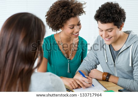 Group Of Happy Friends Studying Together in Class
