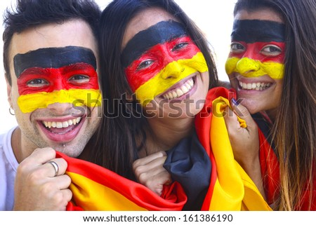Group of happy german soccer fans commemorating victory yelling. - stock photo