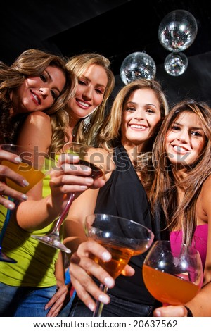 group of happy girls smiling in a bar or a nightclub - stock photo