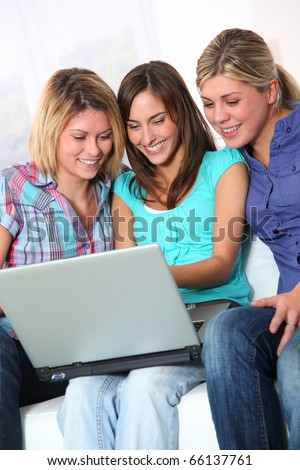 Group of happy girls surfing on internet