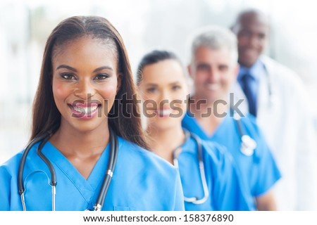 group of happy healthcare workers line up - stock photo