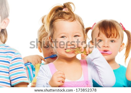 Group of happy kids and and a girl - stock photo