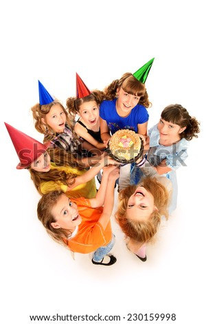 Group of happy kids celebrating birthday with a cake. Isolated over white. - stock photo