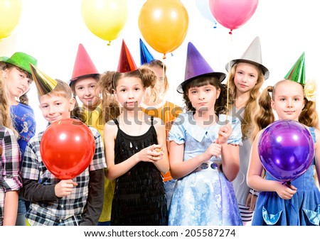 Group of happy kids having fun at a party. Isolated over white. - stock photo