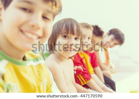 Group of happy kids in row smiling