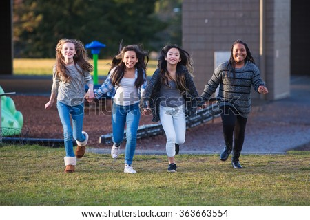 Group of happy kids running outside - stock photo