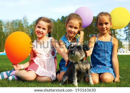 Group of happy kids with balloons on the street - stock photo