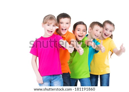 Group of happy kids with thumb up sign in colorful t-shirts standing together -  isolated on white. - stock photo