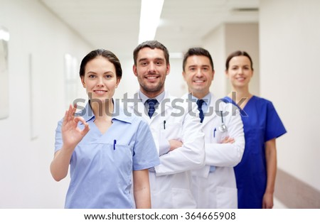 group of happy medics or doctors at hospital - stock photo
