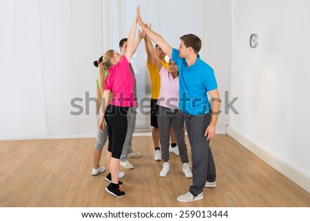 Group Of Happy Multiethnic People Giving High-five - stock photo