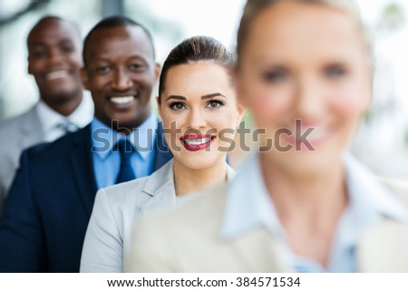 group of happy multiracial business people in a row - stock photo