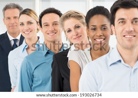 Group Of Happy Multiracial Businesspeople Standing In Row - stock photo