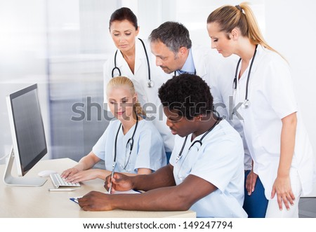 Group Of Happy Multiracial Doctors Working Together In Clinic - stock photo