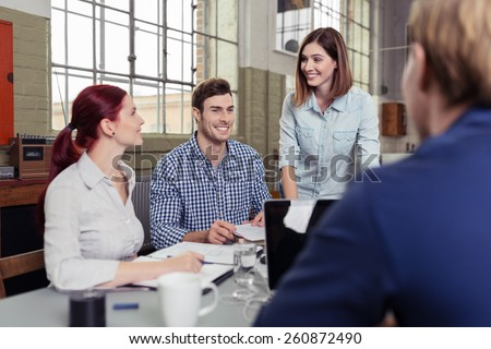 Group of Happy People Discussing at the Table Regarding their School Project. - stock photo